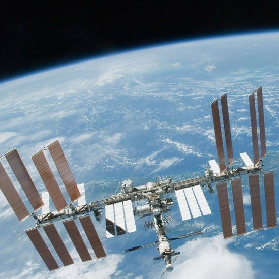 The International Space Station is a habitable man-made SATELLITE in low orbit around earth. It is so large that it can sometimes be seen with the naked eye. The space station serves as an international laboratory for EXPERIMENTS within the environment of space— which is almost impossible to replicate on earth. It took over ten years and more than 30 missions to assemble the station. it is approximately the size of a football field.More INfo - The International Space Station