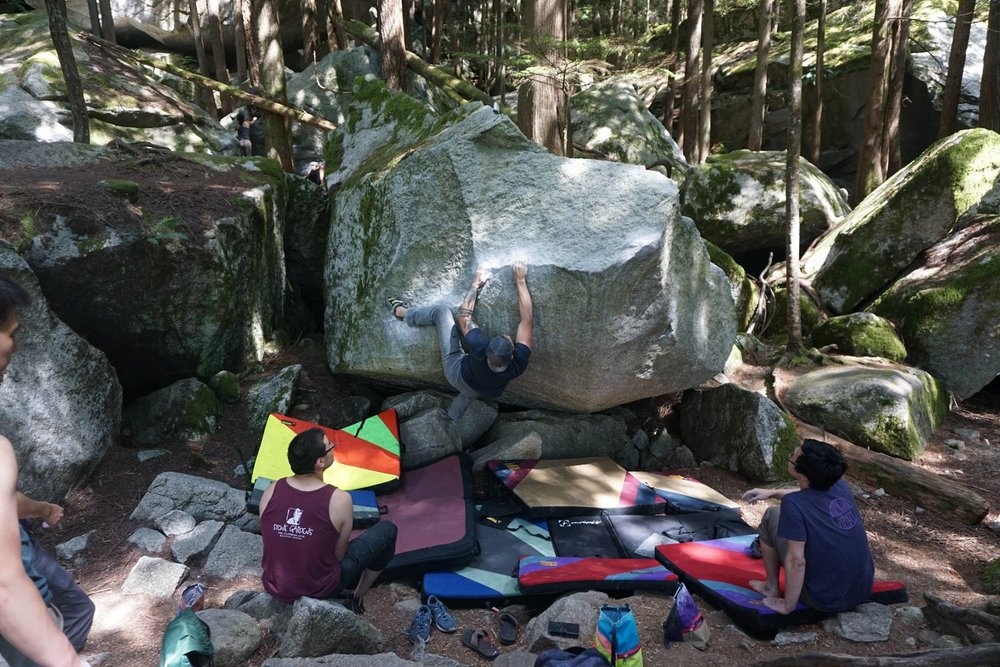 """Exploring Roots Board Member, Andrew Potter, works on a bouldering problem known as """"Easy in an Easy Chair"""" (V4) in Squamish, BC."""