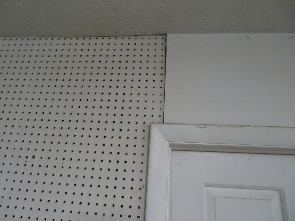 Wood paneling, here peg-board, is definitely not fire-resistant.