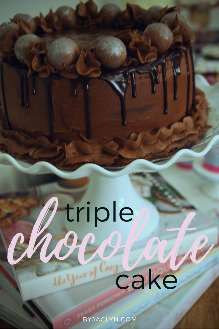A rich moist triple chocolate cake that contains a chocolate ganache filling with a chocolate buttercream frosting and chocolate ganache glaze