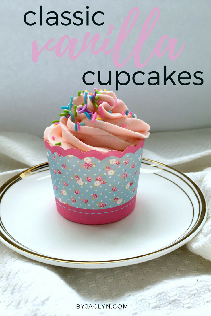 Classic vanilla cupcake recipe topped with a fluffy vanilla buttercream