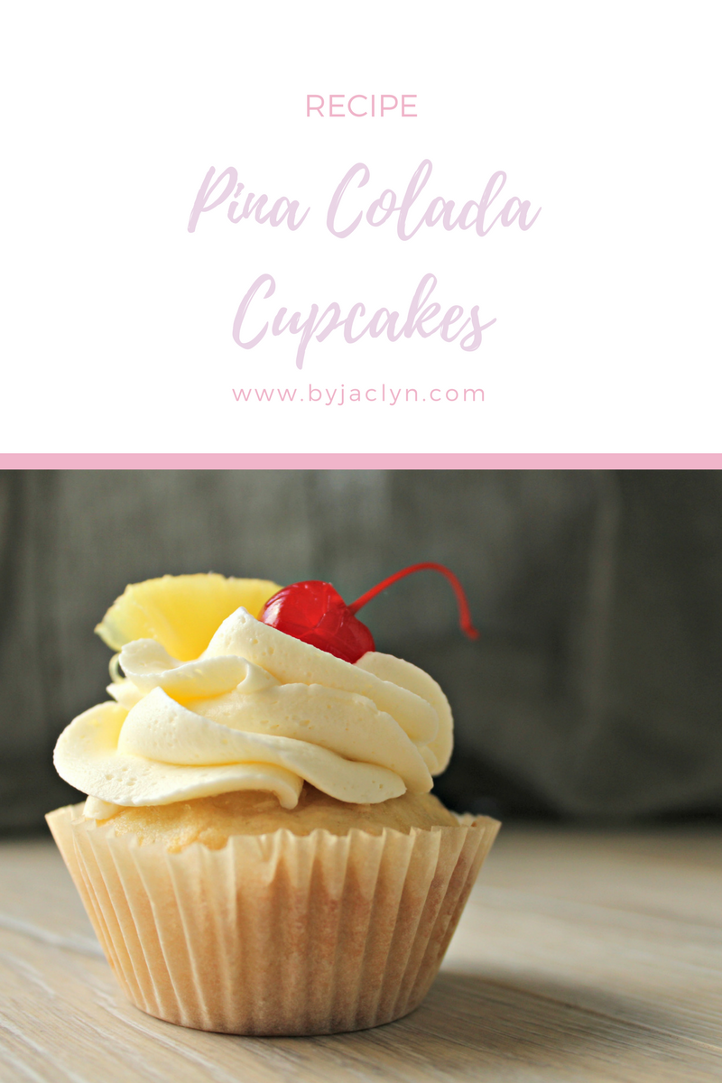 Coconut flavoured pina colada cupcakes filled with pineapple puree and topped with a rum buttercream