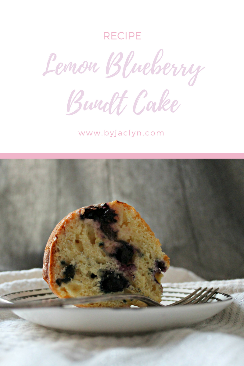 A moist lemon bundt cake speckled with sweet blueberries and topped with a simple lemon glaze