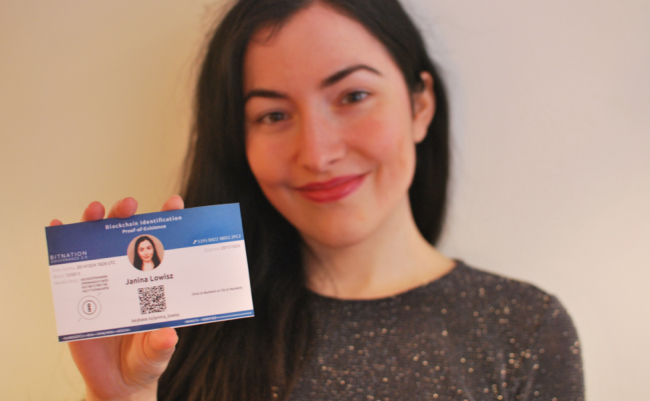 Janina Lowisz showing off a Bitnation ID