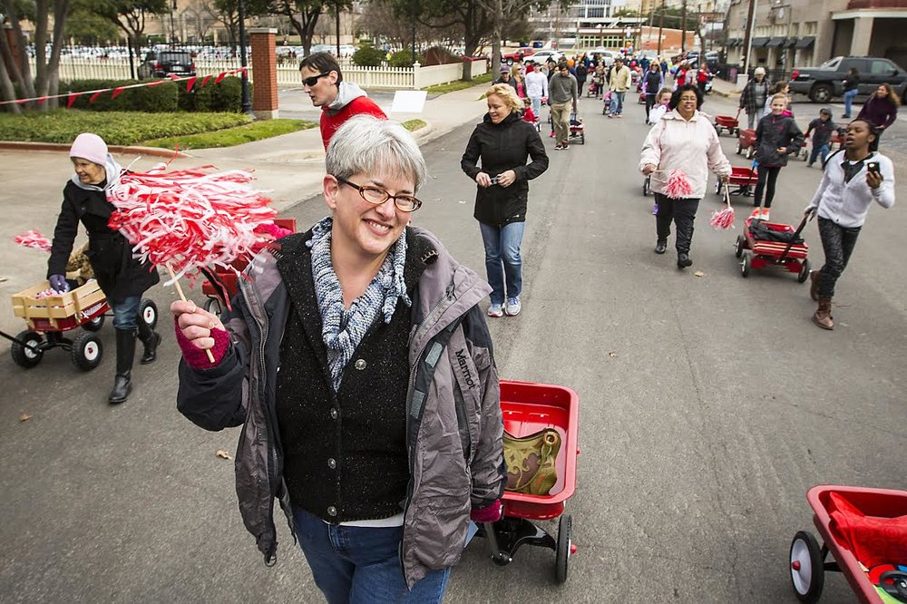 Helping Community Partners for Dallas break the red wagon parade world record. January 2015. Copyright @Smiley N. Pool