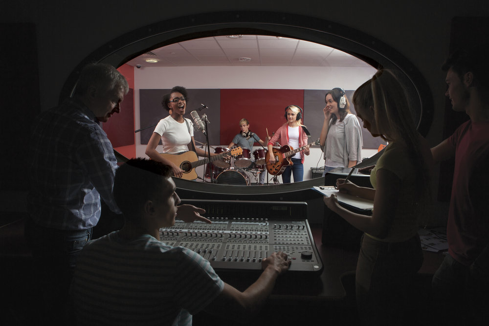 Band-with-lead-singer-in-recording-studio-000028436420_Full.jpg