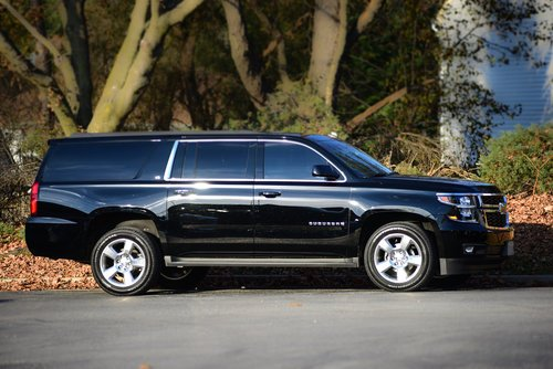 Black Chevrolet suburban limo outside