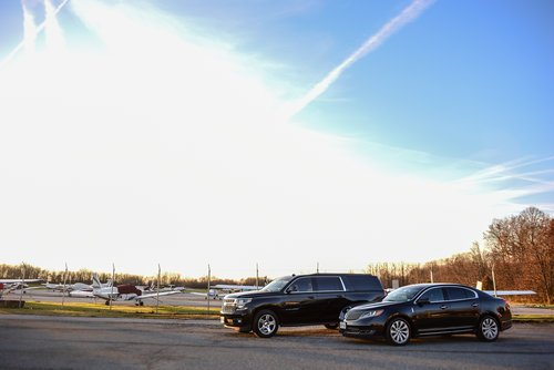 Black Chevrolet suburban limo airport transport