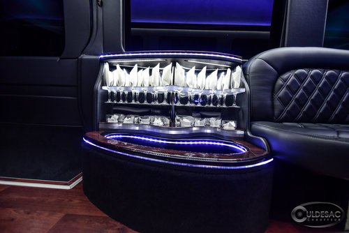 Mercedes sprinter limo champagne glasses