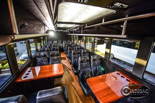 black ford shuttle bus interior tables