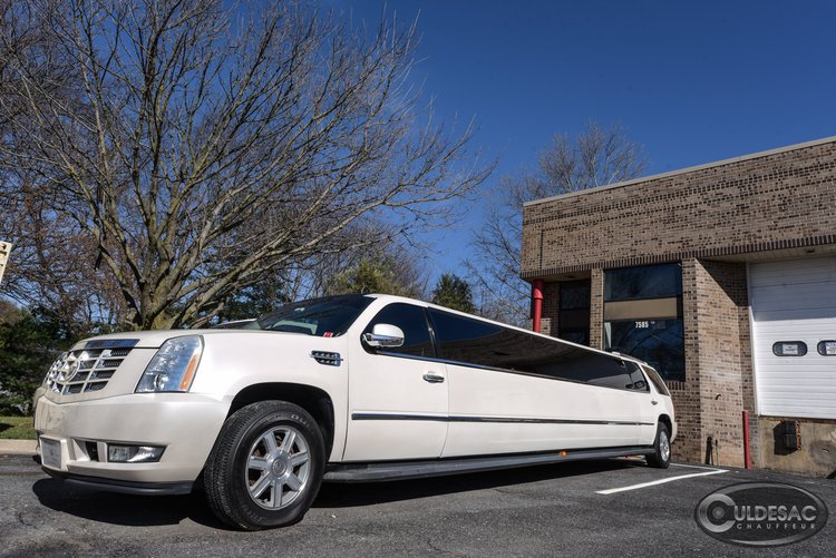 White cadillac esclade limo