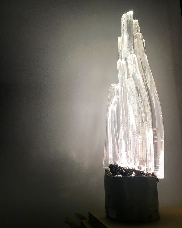 "Alison Chism translates her sculptural forms into beautiful lighting in this ""Crystal Flame"" which shines in the darkness."