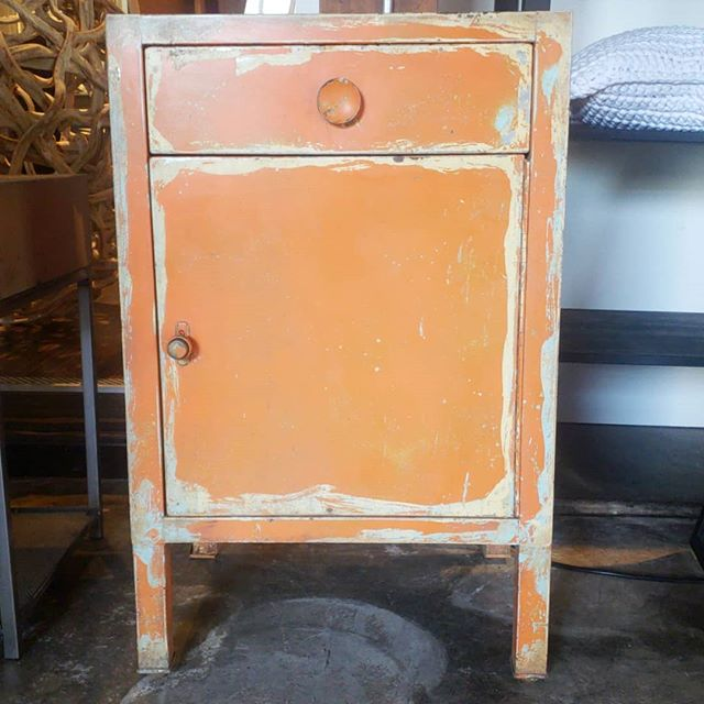 Orange industrial nightstand/end table. Grab this week for $200.