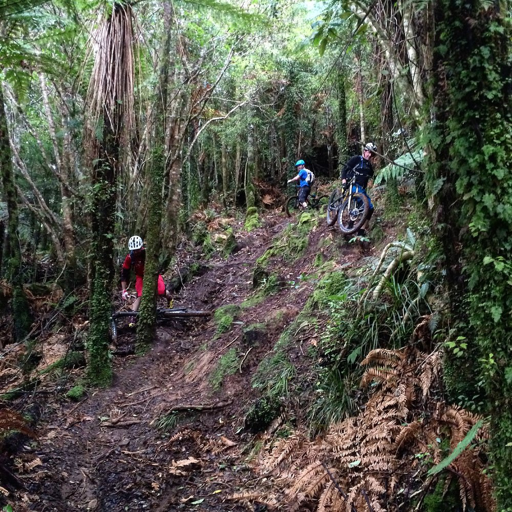 Jono takes one for the team. This section is tough even in the dry.