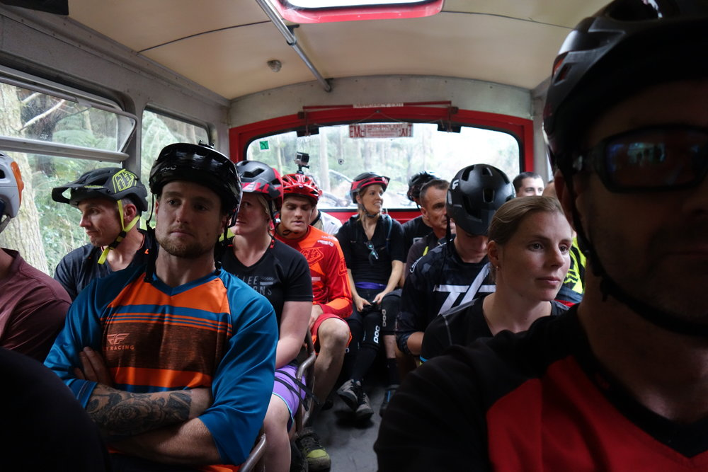 There would normally be more smiles on the bus, but the threat of rain has everyone consternating themselves about how the hell will they get down the stages in one piece.