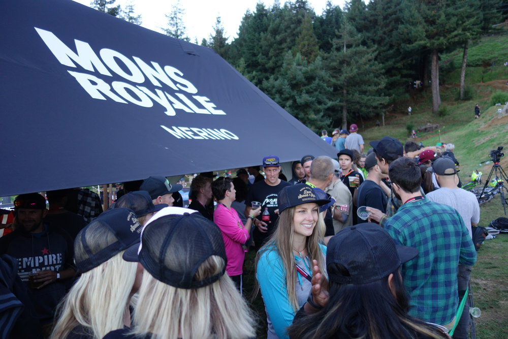 Lucky for Pinkbike I get sidetracked by a VIP party at the Mons Royale tent. Beer and trackside action. I love Crankworx.