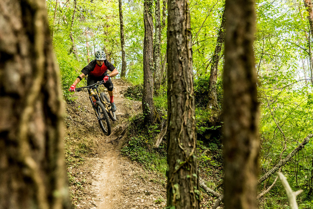This is me riding the Nomad in Sospel, France. Bars seemed to turn ok. I put that down to bearings in the headset. Genius.  Sven took this pic. I know this 'cause I saw him hiding in the trees.