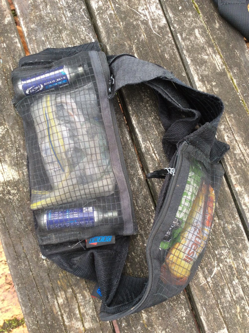 The main velcro removable zippered unit held all my shit for trailside repairs and the front one my sugar stash. The Batman and me are like homies now.