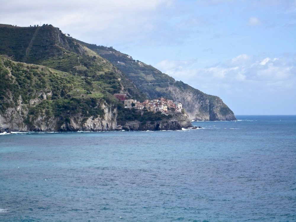 Manarola, one of it's neighbor villages, can be seen in the distance.