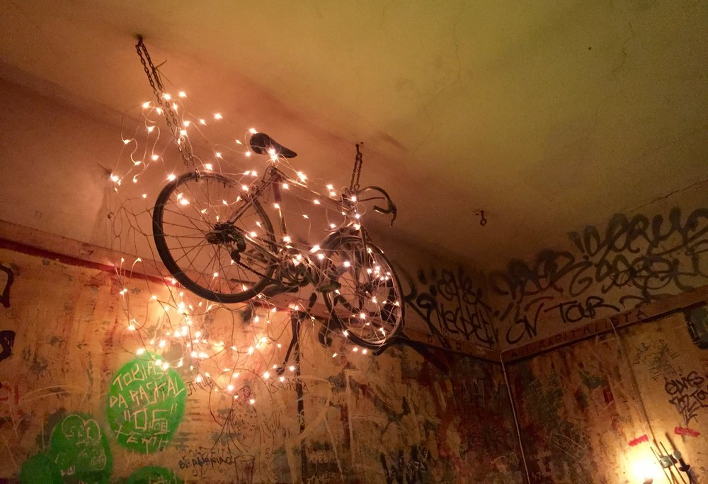 The quirky interior design of Szimpla kert is filled with graffiti walls and odd furnishings.