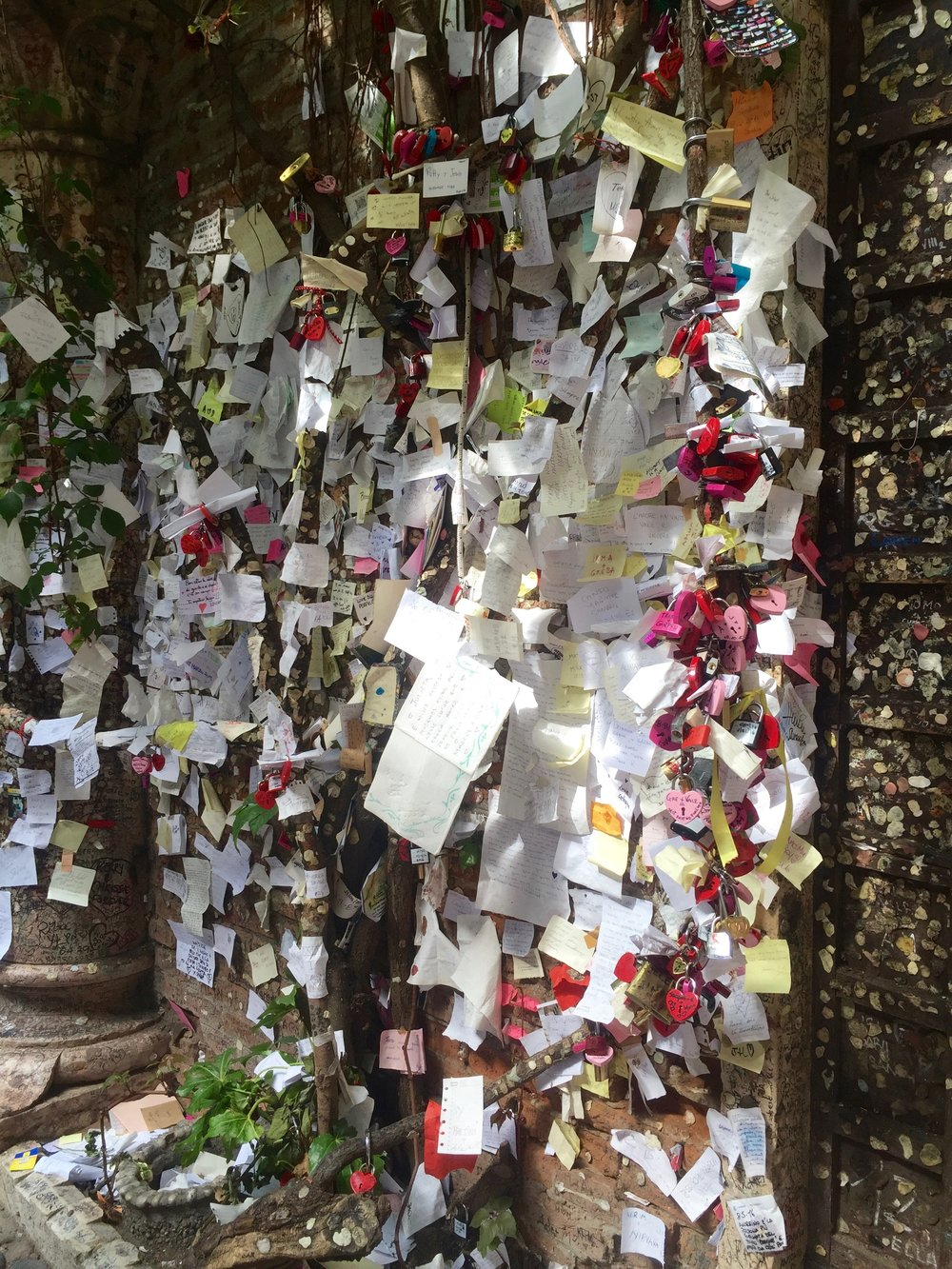 A wall full of love letters and locks left by visitors