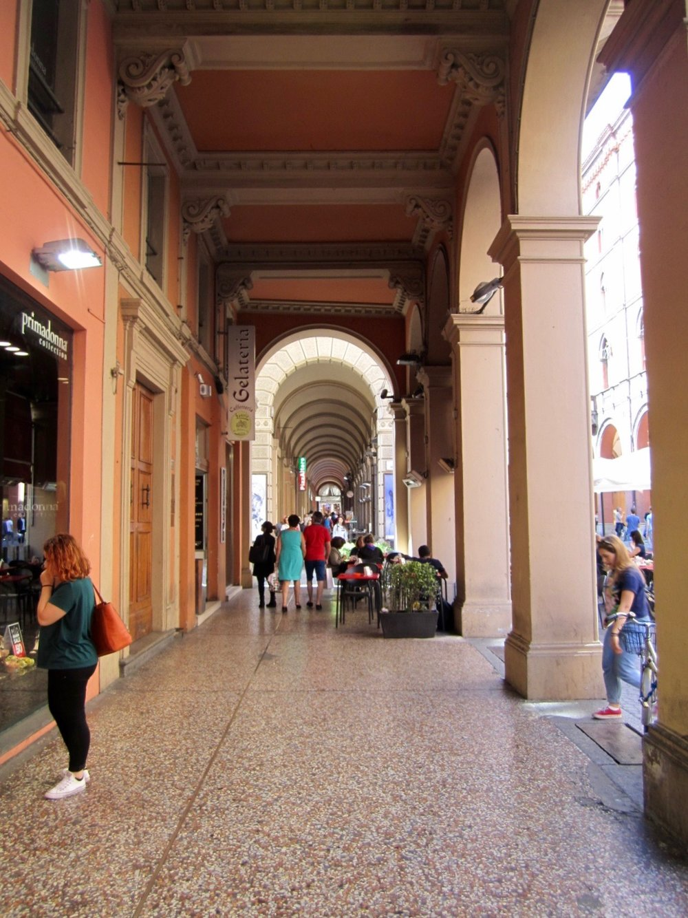 Bologna is known for its beautiful archways and burnt orange buildings, which provide much needed shade from the scorching sun,
