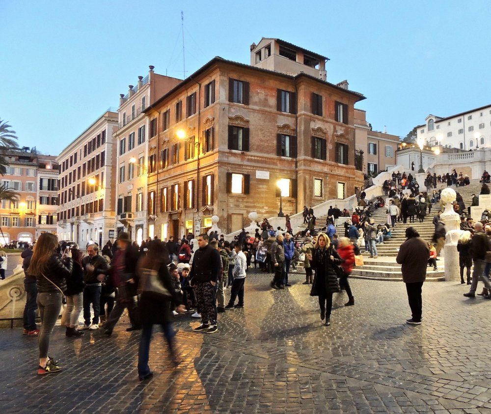 Tourists hanging out at the Spanish steps