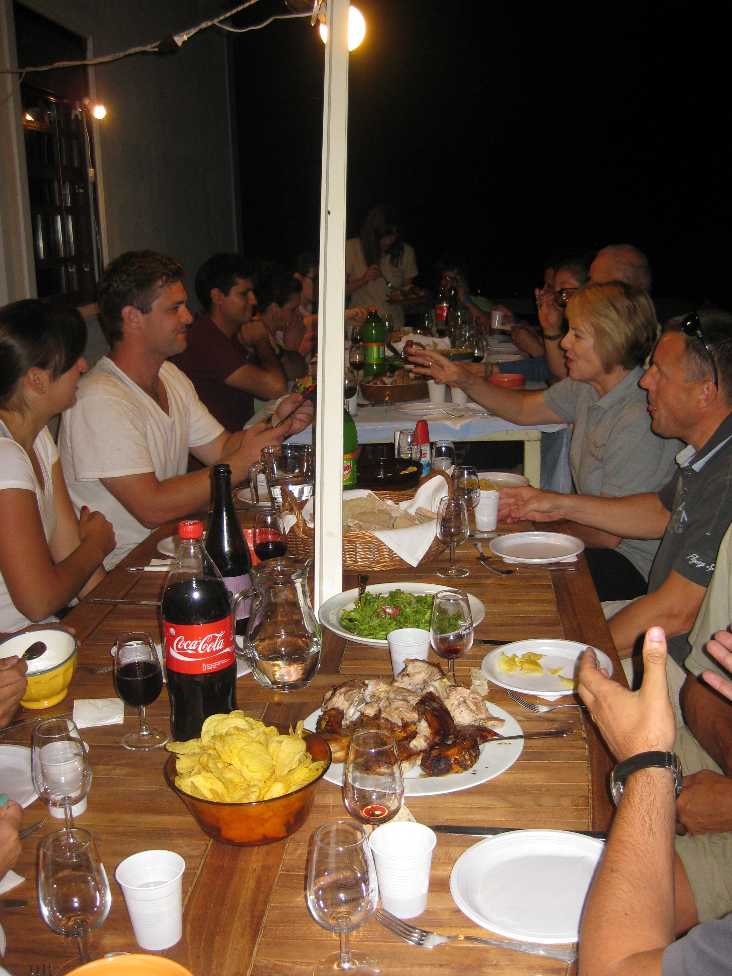 Conviviality: notice the wine glasses are empty and the Coke bottles are full