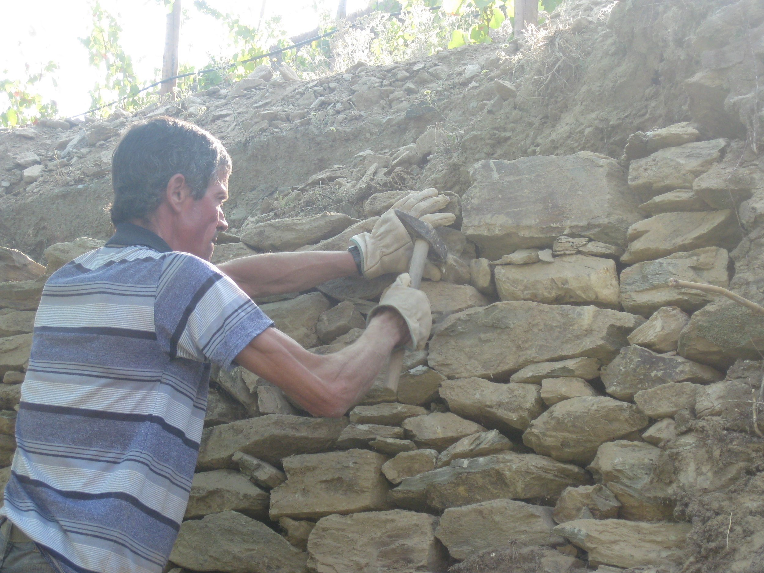 Filling in with smaller rocks for strengthening walls.