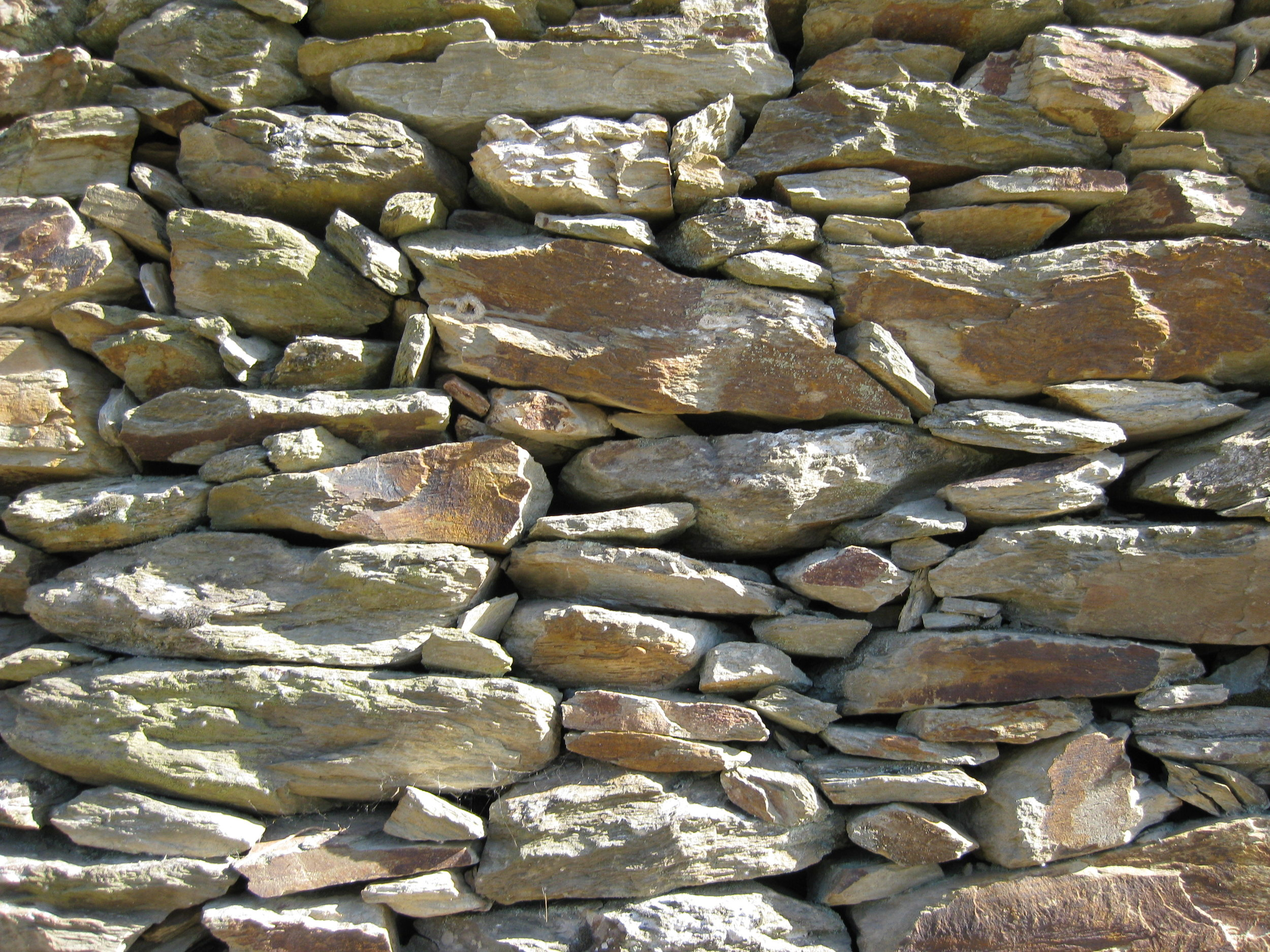 Typical Douro Valley schist wall - stones are softer and smaller stones keep soil in place.