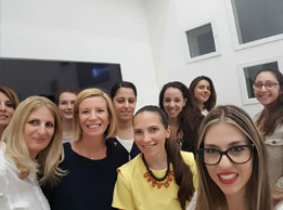Simone coaching twelve young unemployed university graduates at EY Cyprus for the Women Fit for Business program.