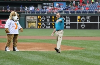 Philadelphia Freedom Valley YMCA Board Chairman Jeff Lutsky throws out the first pitch at the Phillies game during YMCA Night.