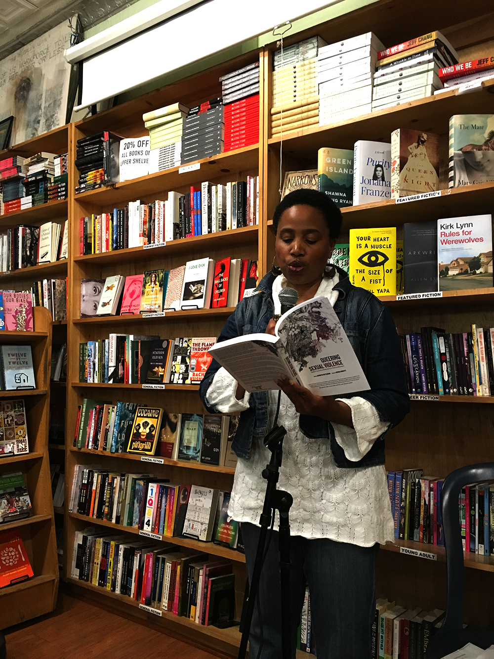 Aishah reading from her Piece in the queering Sexual Violence Anthology