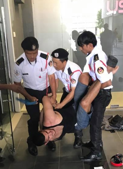 big-mma-fighter-takes-on-petite-security-guard-in-subang-jaya-condo-world-of-buzz-2.jpg