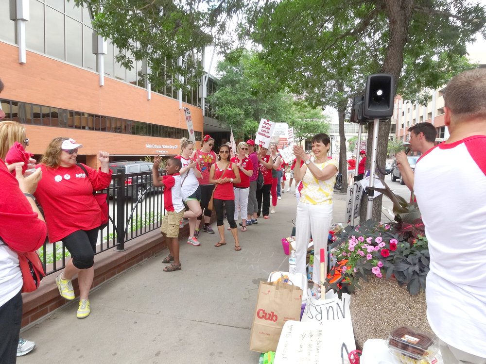 Sandy, walking in solidarity with the striking Allina nurses as they continue to fight to protect their health care access.