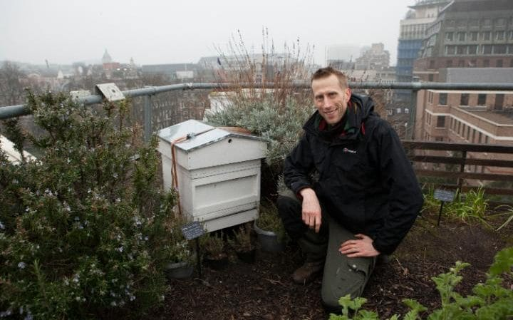 "Head Gardener for Bee London Sean Gifford at the beehive at Le Cordon Bleu"" CREDIT: RII SCHROER"