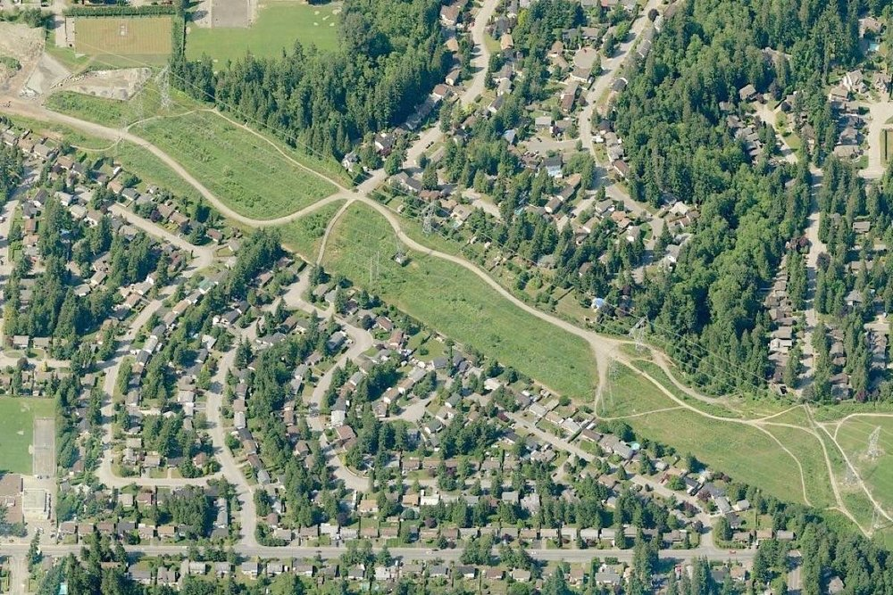 Plans call for cultivation of urban agriculture along the 23 acre (9.4 ha) BC Hydro transmission right-of-way between 200 Streets next to the Uplands Off-Leash Dog Park in Langley City. Undated Bing.com image