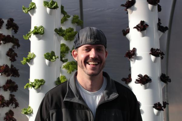 Joel McKinney with his hydroponic towers.
