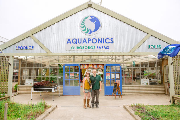 Aquaponic farmers Jessica Patton and Ken Armstrong at Ouroboros's farm stand  Courtesy of Ouroboros Farm