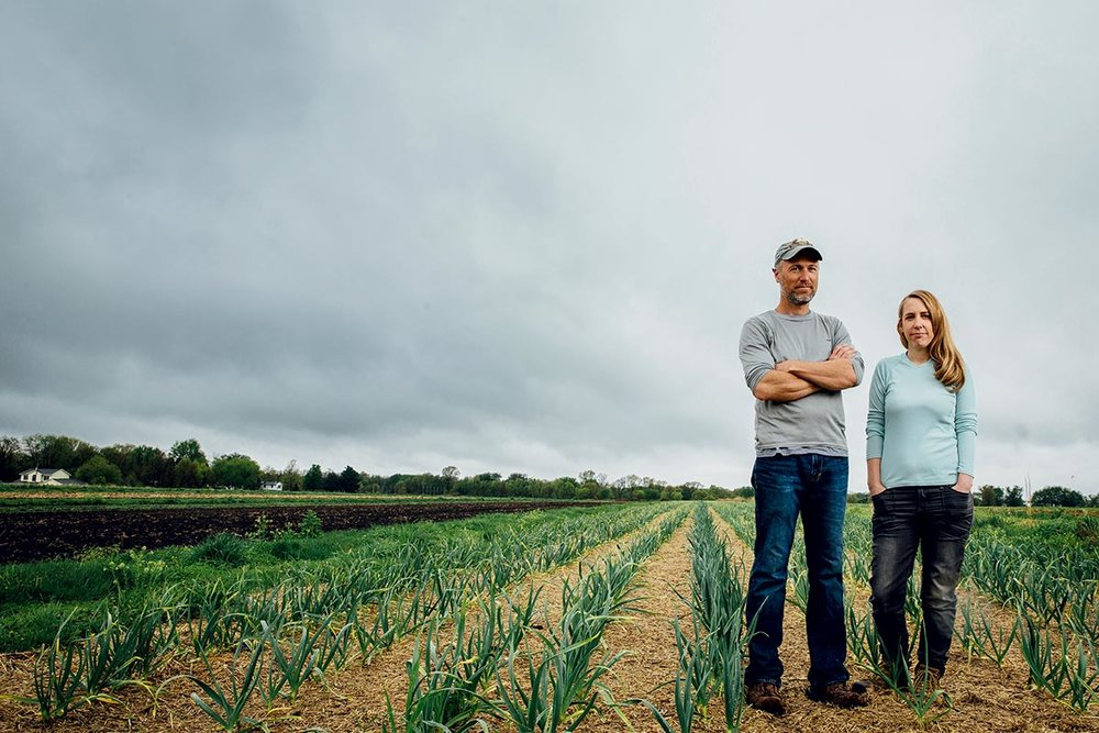 Andrew (left) and Melissa Dunham, both 37, operate an organic farm in Grinnell, IA, that has twice fallen victim to pesticide drift.  PHOTO: Kathryn Gamble