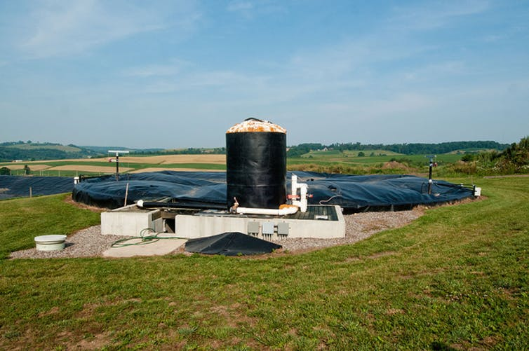 Anaerobic digester systems like this one at Pennwood Dairy Farms in Berlin, Pennsylvania, capture biogas for energy production from the breakdown of manure while reducing pathogens and controlling odors.  USDA ,  CC BY