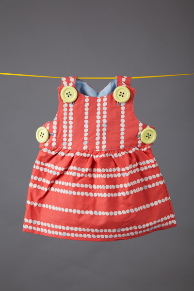 quirky studio dress shot on washing line of yellow ribbon