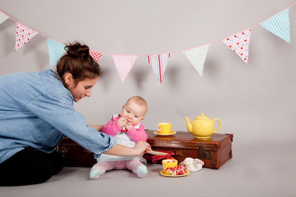 studio session for products with child models, Jodie of Tumbling Birds fixing props