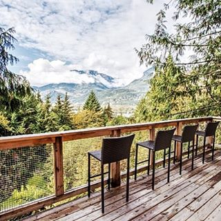 The upper #deck of the #cabin is a magical spot to contemplate the view or share a drink with a friend. Tag a friend who would enjoy the view with you!  Photo credit to #jannickekitchenphotography #timberwolfhomes #tinyhome #microhome #cabininthewoods #cabinporn #squamish #instagood #like4like