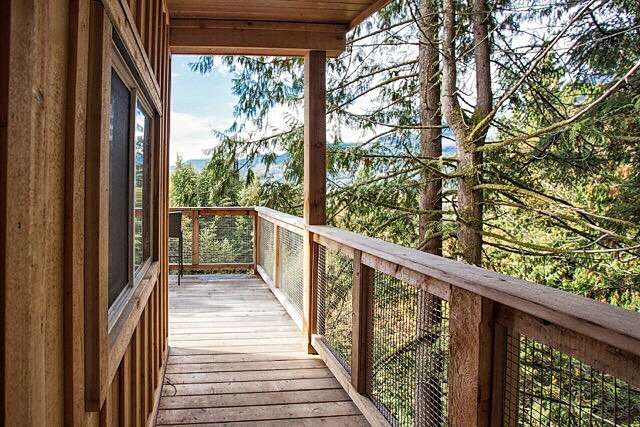 As you approach the cabin you are drawn end of the deck to look out over the valley. Photo credit to #jannickekitchenphotography.  #timberwolfhomes #tinyhouse #tinyhome #cabin #cabininthewoods #cabinlife #forest #squamish