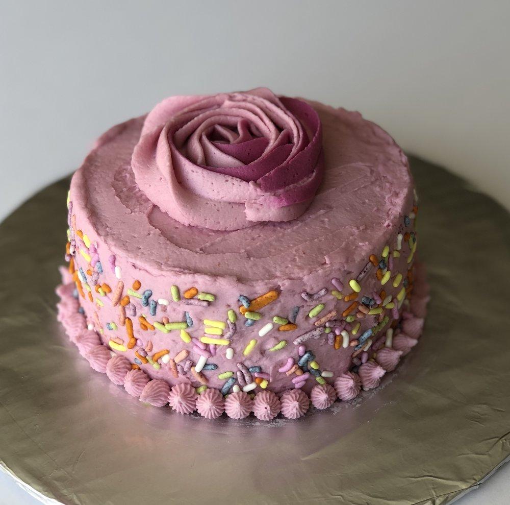 "Rosie's 2 Year Celebration Cake! Gluten, Dairy & Soy Free Vanilla Cake with DF Butter Cream Frosting  $20 One layer 4"" round 2"" high"