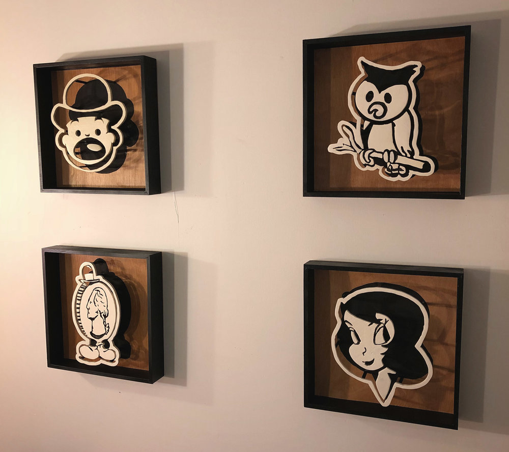 """Selected works from the """"Surprise!"""" series  each work 12 x 12 inches wood, stain, acrylic"""