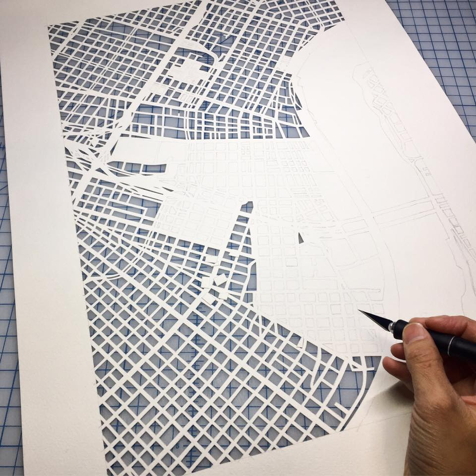 Hand cut map of New Orleans by Karen O'Leary of Studio KMO