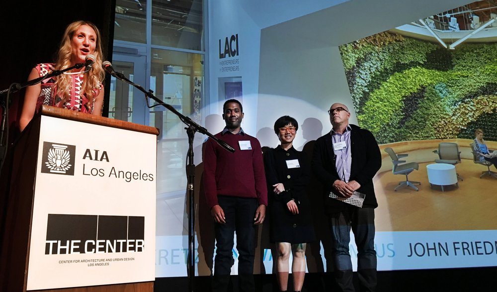 Principal John Friedman, FAIA, right, accompanied by Associates Derek Greene (left) and Shuang Xu, accepted the awards on behalf of the firm.