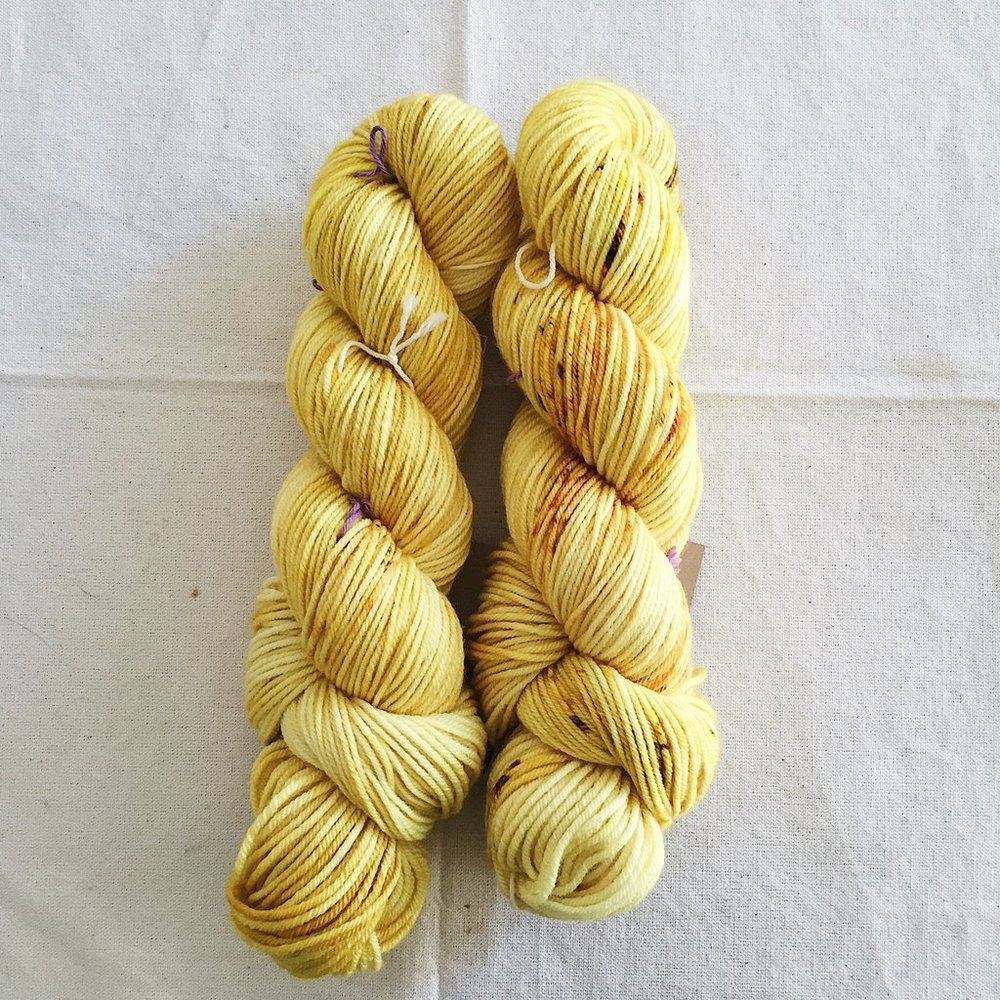 I received this colorway, Brass, in a sock weight yarn as part of a color club, & I melted - it is drop dead gorgeous! The name says it all - it's brassy, warm, & basically perfect. Photo by  Madelinetosh .
